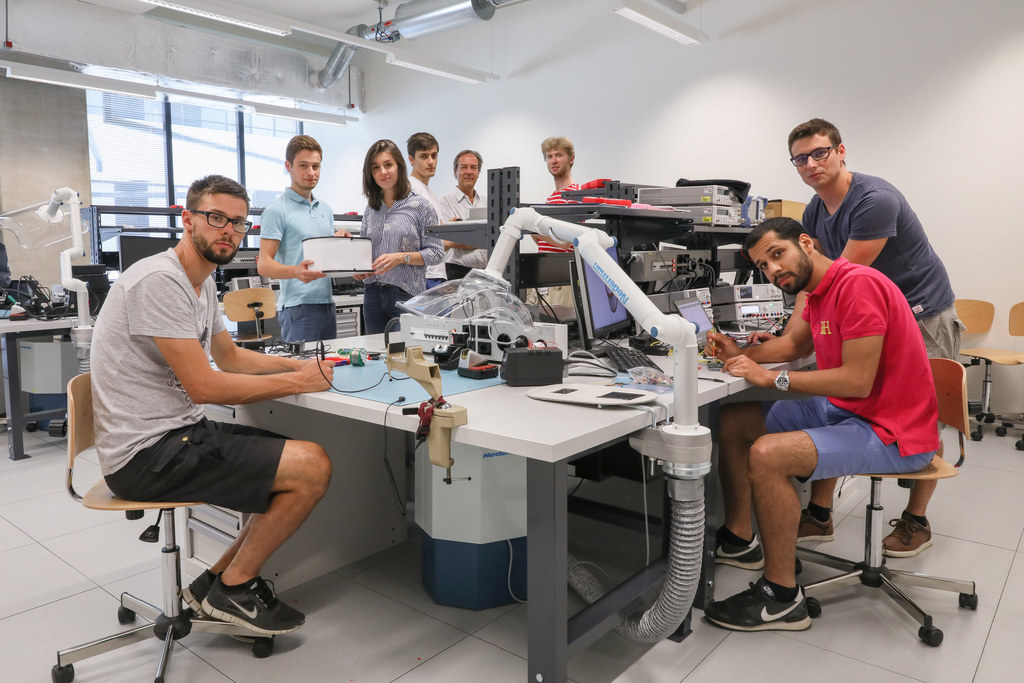 Group of students around a table working on an experiment