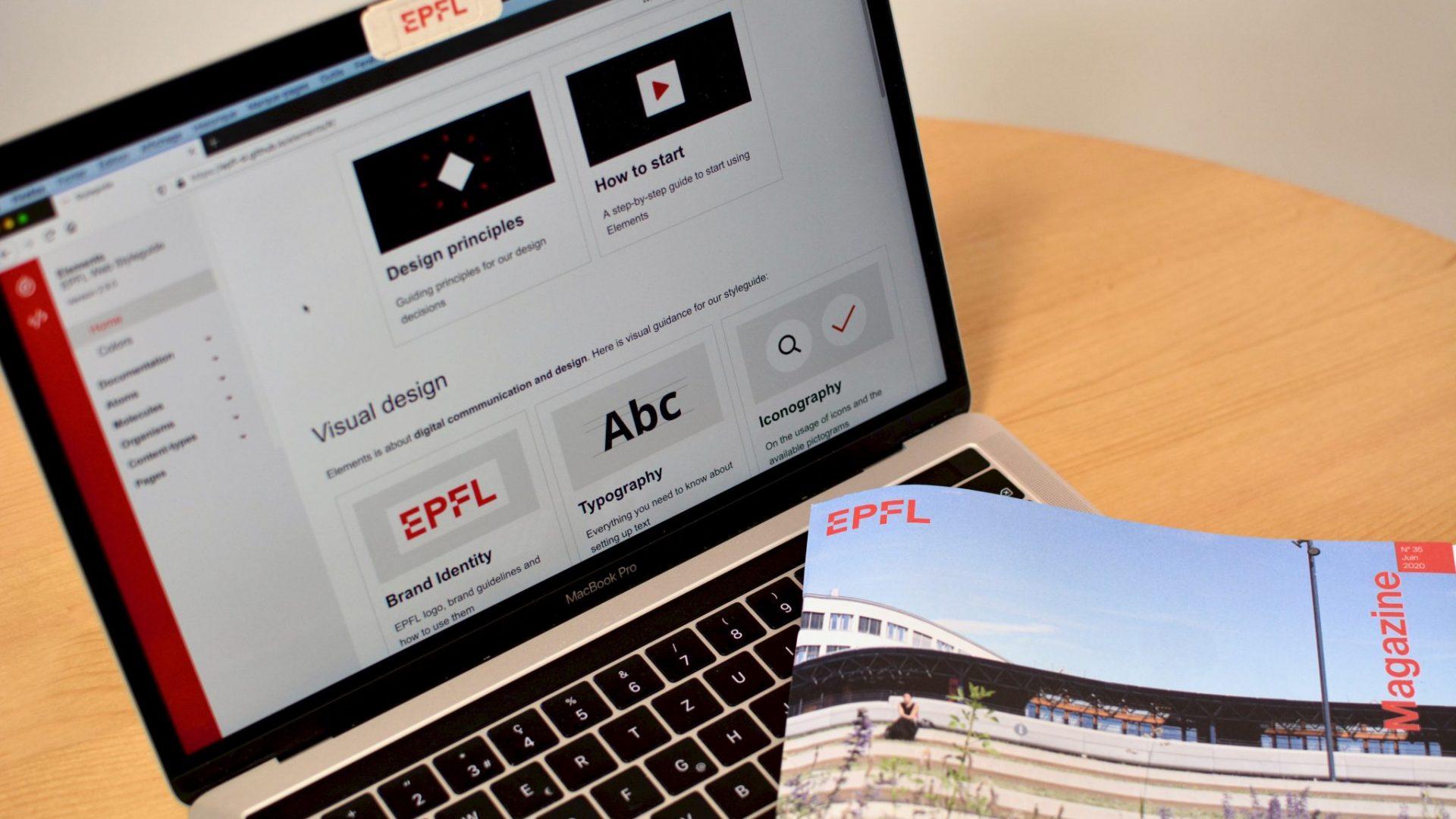 Ordinateur avec un EPFL Magazine possé dessus