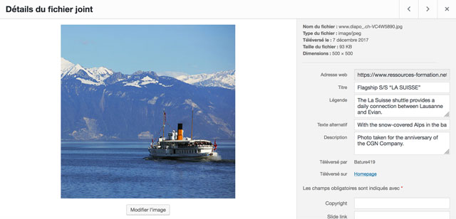 With the snow-covered Alps in the background, the La Suisse vessel crosses the blue waters of Lake Geneva.