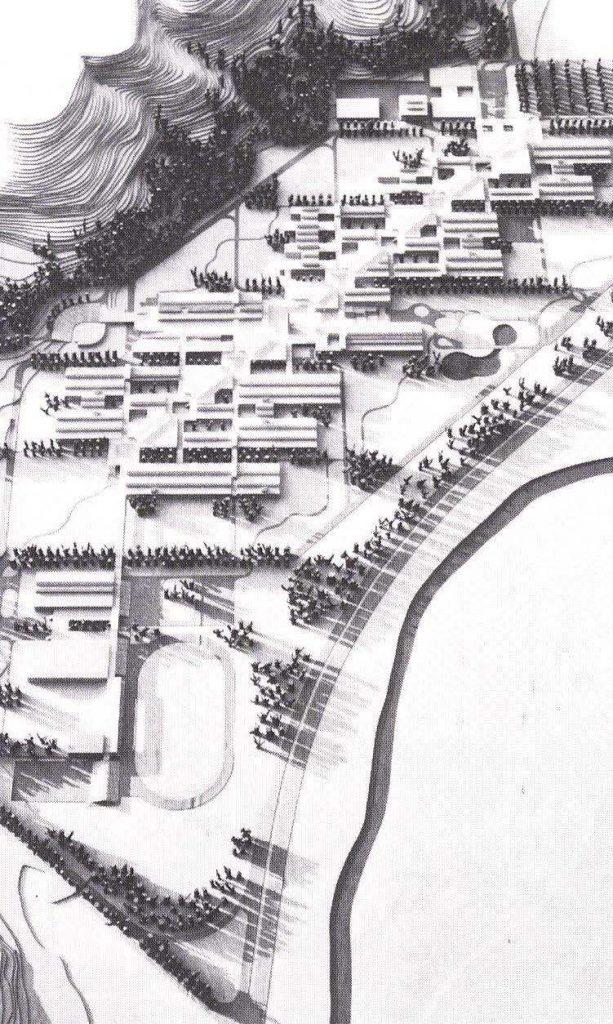 Maquette de l'université d'Annaba photographiée depuis le haut. Les bâtiments de forme rectangulaire s'articulent de part et d'autre d'une diagonale. L'école est bordée par un plan d'eau en bas à droite et par une colline en haut à gauche.