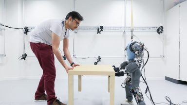 Robot playing with human and table