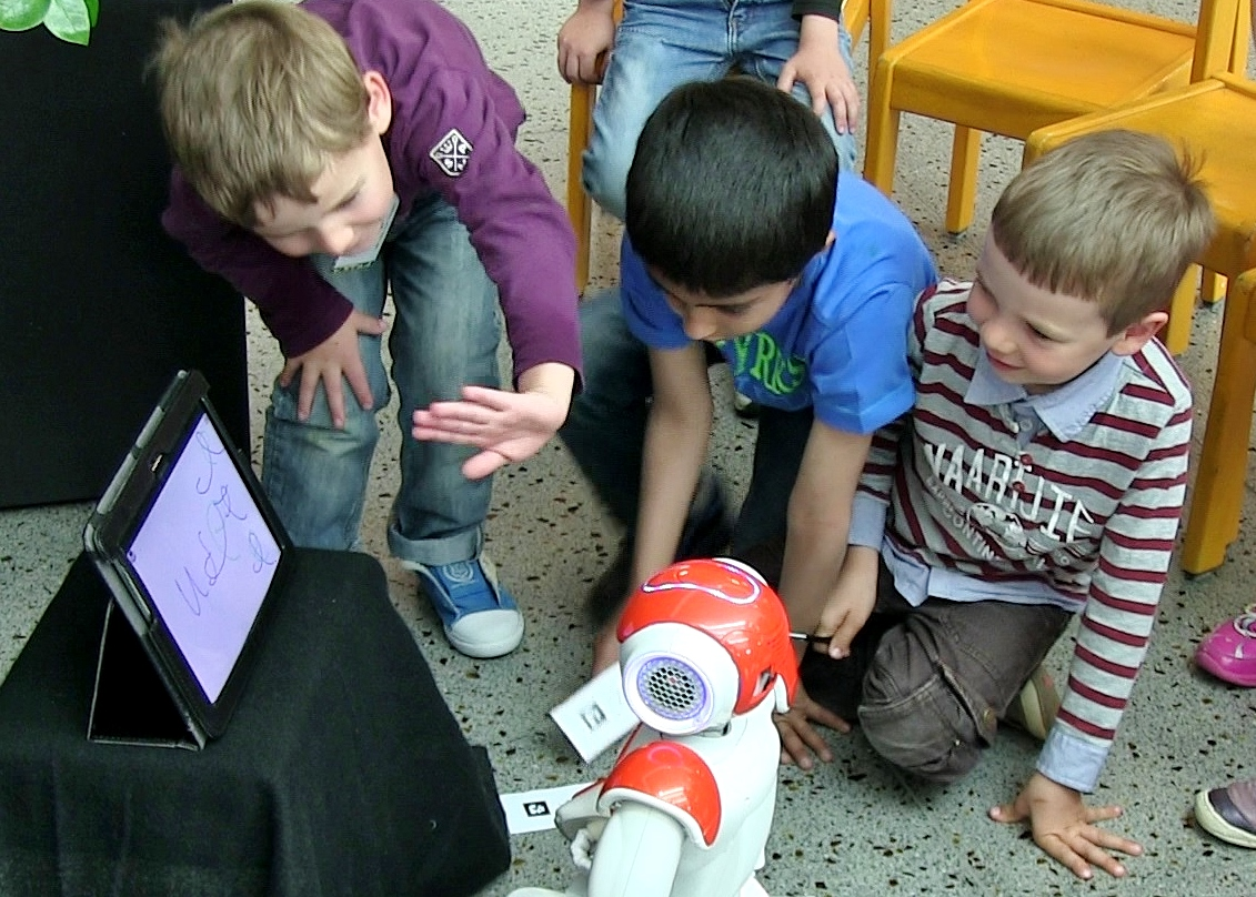 Several young children interacting with the robot