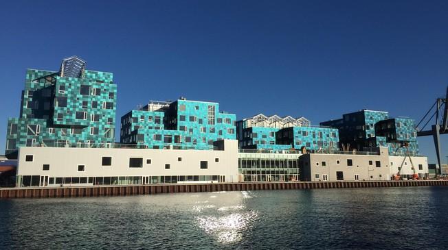 Copenhagen International School waterfront view with colored solar cladding