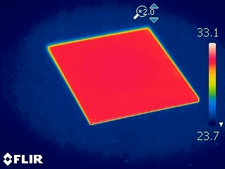 illustration: below transition temperature - transparent thermochromic film - red in image