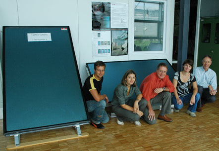 new panels and groupe of people who were involved in its development smiling at the camera