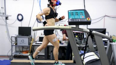 Athlete running on a treadmill equipped with all the instrumentation