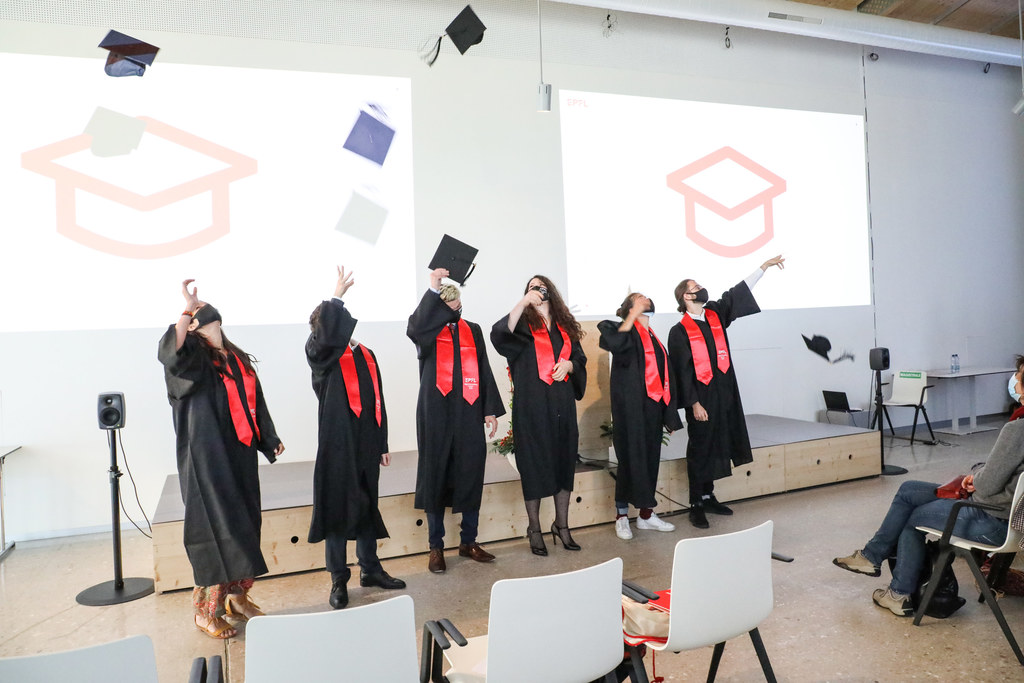 DH students throwing their hats after graduation