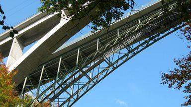 view from below of concrete bridge in Lausanne, Switzerland