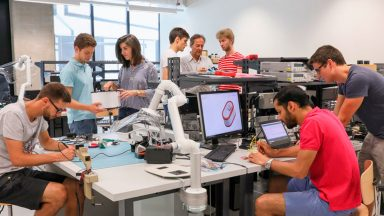 EPFL students working on portable biosensor